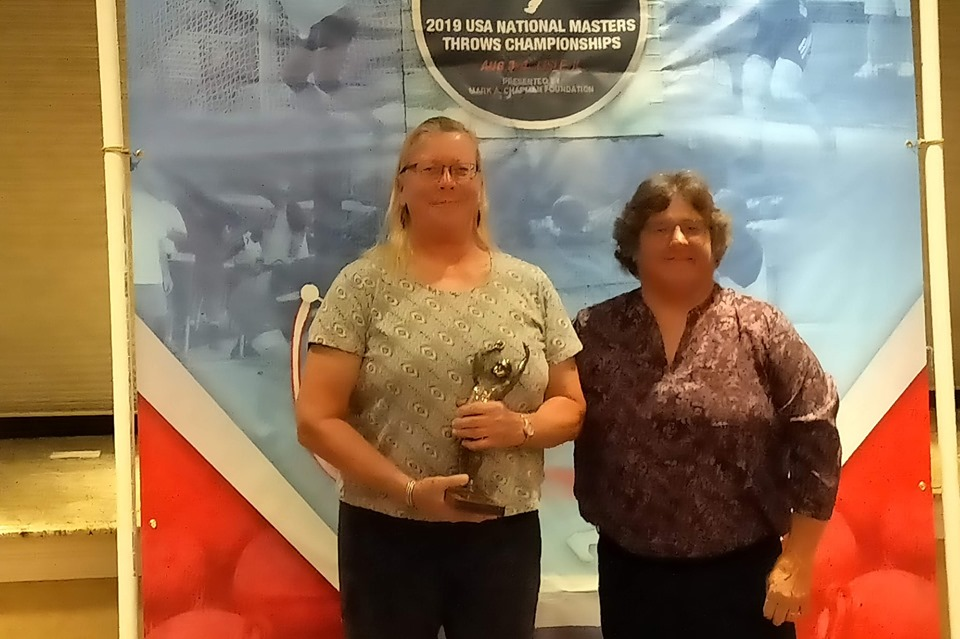 Carol Finsrud, left, won the Vanessa Hilliard Award as Female Thrower of the Year for the second consecutive year -- with Throwing Events Subcommittee Chair Sue Hallen.